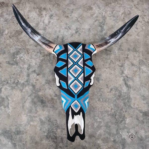 Cabeza de vaca estambre negra azul
