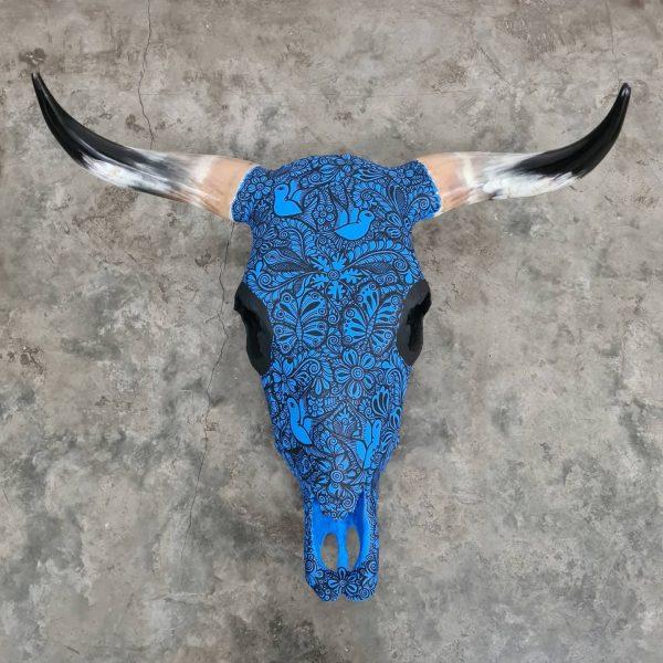 Cabeza de vaca pintada azul